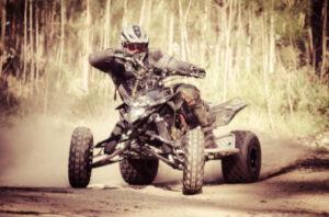 ATV racing through dirt trail: RedLawList Accidents & Injuries Blog