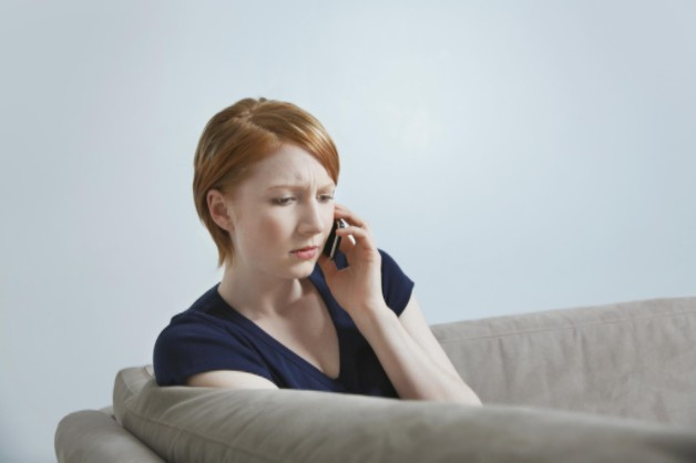 woman calling about insurance dispute